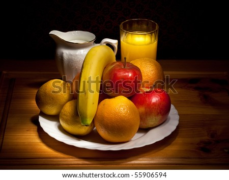 still life of fruit, a cup with juice and milk jug