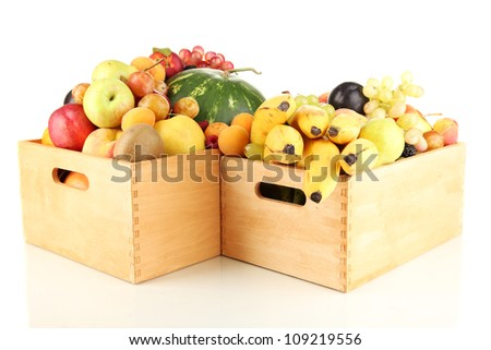 Still life of fruit in a boxes isolated on white