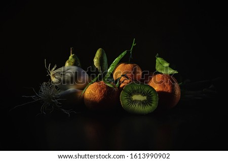 Still life of fruits and onions