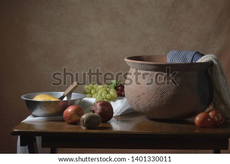 still life of fruits on the table in deep brown background #1401330011