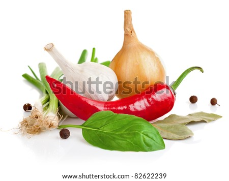 still life of garlic onion pepper and spice isolated on white background