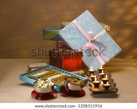 STILL LIFE OF GIFT BOXES, SWEETS, DRY FRUIT BOX, NUTS AND DIYAS