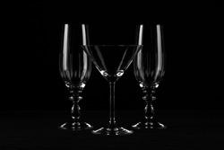 still life of glasses against black background