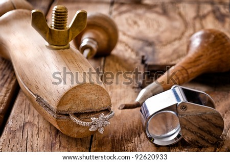 Still life of goldsmith's tools with diamonds ring