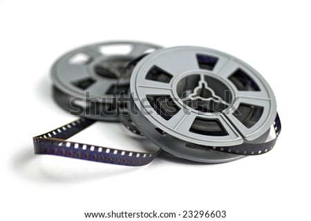 still life of 8mm cine film and reels; isolated on white ground; differential focus