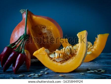 Still life of pumpkin and pepper