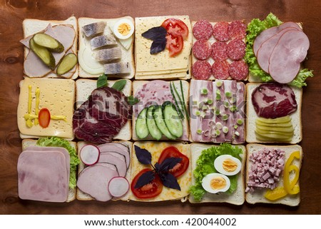 Still life of sandwiches on a wooden background #420044002