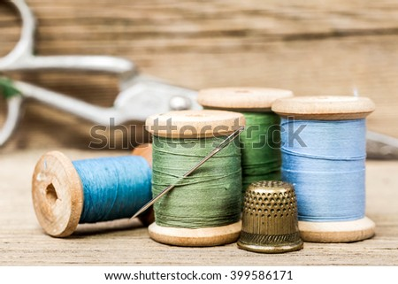 still life of spools of thread on a wooden background