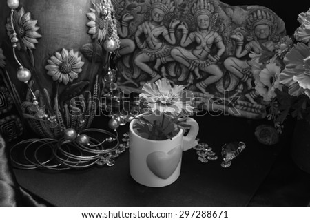 still life of the contrast black and white with cultural and modern objects