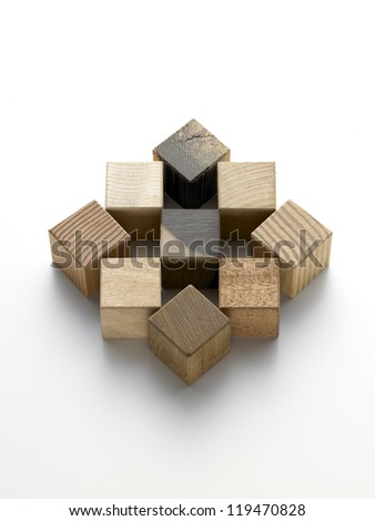 still life of various wooden cubes on a white background