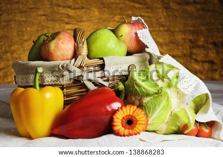 Still Life Of Vegetables And Fruits With Basket.
