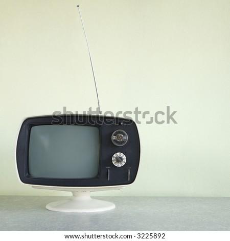 Still life of vintage television set with antenna raised. - stock photo