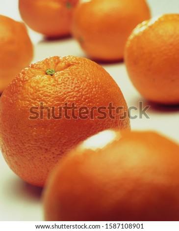 Still life of whole oranges on white background