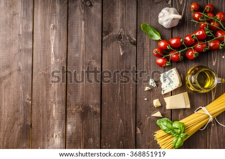 Still life photo, background with pasta and cheese, delicious san marzano tomatoes, place for your advertising Stock fotó ©