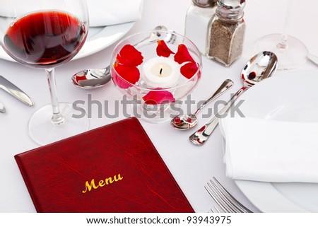 Still life photo of a menu on a restaurant table.