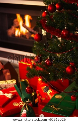 Still life photo of christmas presents and christmas tree in the living room.?