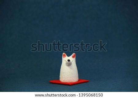 Still life photo of Japanese white fox figurine