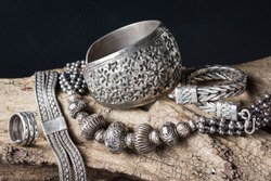 Still life photography : Collection of antique traditional silver jewelry on old wood
