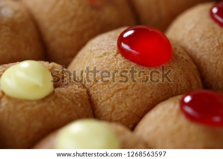 Still life photography of dessert : Doughnuts ball with custard and jam. Selective and selective focus and free space for text. Shooting in studio, Clean food good taste idea concept. #1268563597