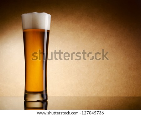 Still life photography of light beer glass