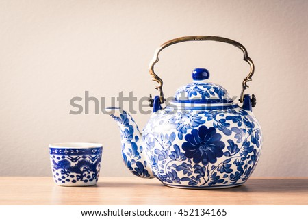 still life photography : traditional chinaware teapot and cup on wood table ( blue and white pottery )