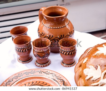 Still Life Pottery. Pitcher and plates made of clay