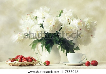 still life, splendid bouquet snow-white peony and sweet aromatic strawberry