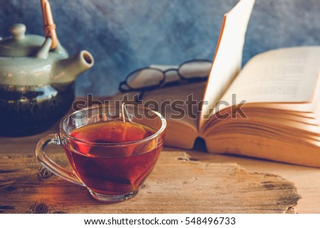 Still life tea time with book #548496733