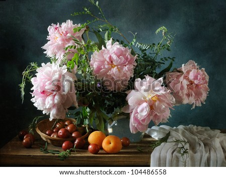 Still life with a beautiful bouquet of peonies and fruit