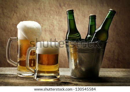 Still Life with a  beer in the mug and bottles of beer in basket