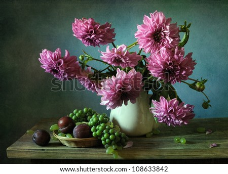 Still life with a bouquet of dahlias and plums