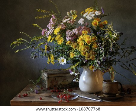 Still life with a bouquet of filed flowers and a cup of tea