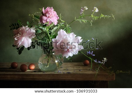 Still life with a bouquet of peonies and apricots