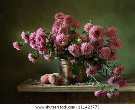 Still life with a bunch of asters and peaches