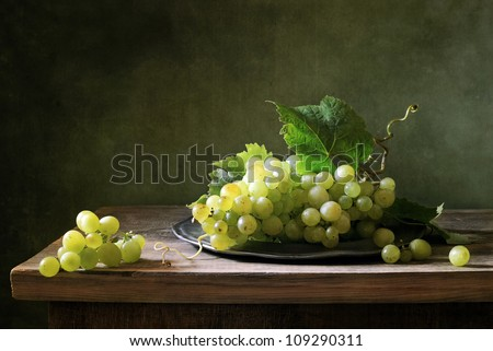 Still life with a bunch of green grapes