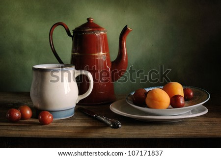 Still life with a coffee pot and apricots