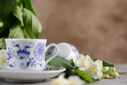Still life with a cup of tonic green tea with jasmine.
