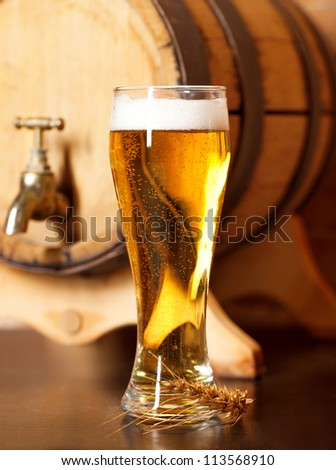 Still life with a draft beer by the glass - stock photo