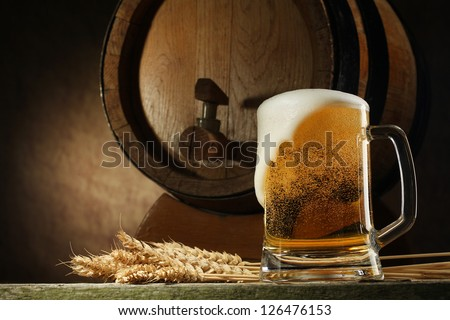 Still Life with a keg of beer and beer in the mug