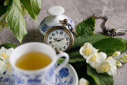 Still life with a magnificent tea set and jasmine flowers. Time to drink tea.