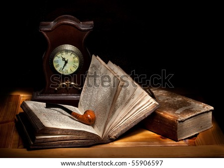 still life with a pipe, open bible and a clock