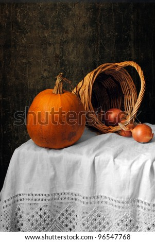 Still life with a pumpkin and onions