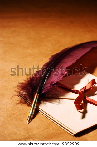 Still-life with a quill and a letters on a background of a rough paper surface