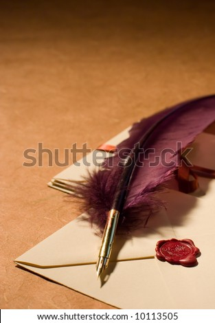 Still-life with a quill and a letters on a background on a rough paper surface.