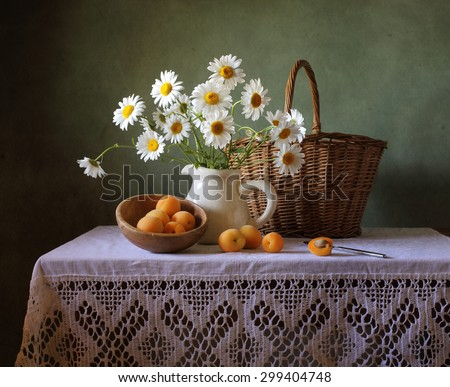 Still life with a summer bouquet and apricots