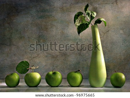 still life with a vase and a green apple