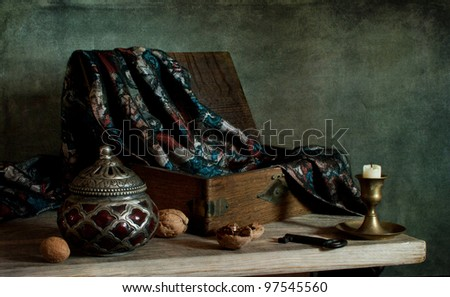 Still life with a wooden box and nuts