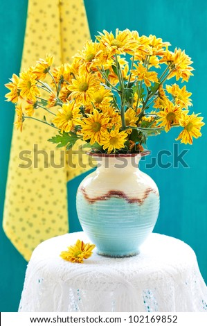 Still life with a yellow flowers chrysanthemum.