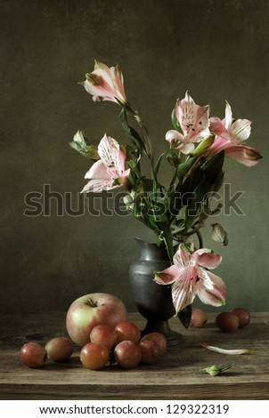 Still life with alstroemeria and fruit