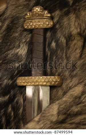 Still life with ancient scandinavian sword on a fur